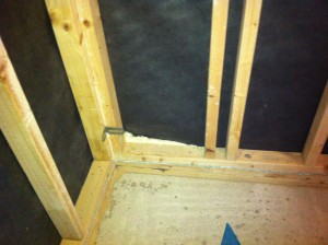 How to insulate stud partition walls at floor level